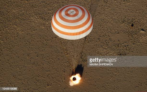 TOPSHOT The Soyuz MS08 space capsule carrying the International Space Station crew of NASA astronauts Andrew Feustel and Richard Arnold and Roscosmos...