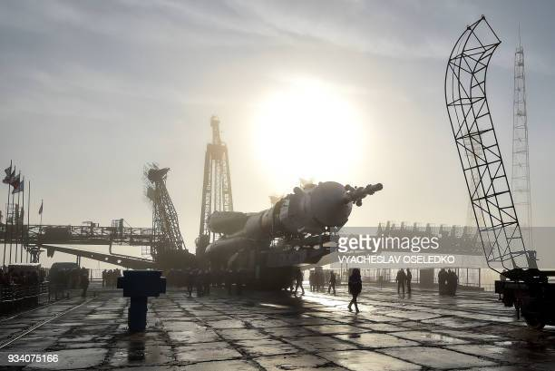 TOPSHOT The Soyuz MS08 spacecraft is mounted on the launch pad at the Russianleased Baikonur cosmodrome in Kazakhstan on March 19 2018 The launch of...