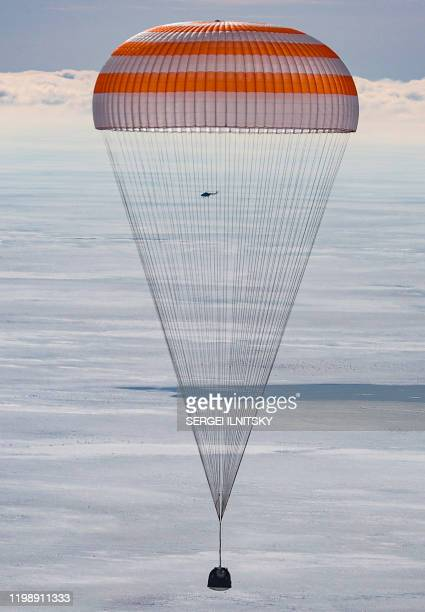 The Soyuz MS13 capsule carrying the International Space Station crew of NASA astronaut Christina Koch Russian cosmonaut Alexander Skvortsov and Luca...