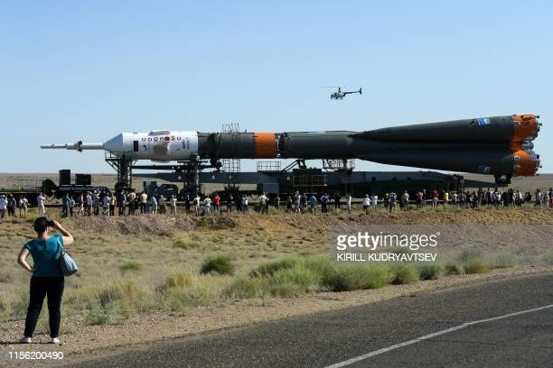 The Soyuz MS13 spacecraft is transported to the launch pad at the Russianleased Baikonur cosmodrome in Kazakhstan on July 18 2019 Members of the...