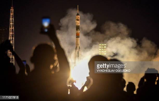 The Soyuz MS15 rocket carrying three crew members of the International Space Station flies moments after blasting off to the ISS from the launch pad...