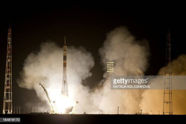 The Soyuz TMA08M spacecraft blasts off from the Russian leased Kazakhstan's Baikonur cosmodrome early on March 29 2013 A Russian rocket carrying an...