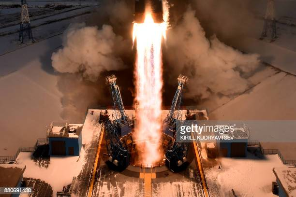TOPSHOT The Soyuz21b rocket carrying Russia's MeteorM 21 weather satellite and other equipment lifts off from the launch pad at the Vostochny...
