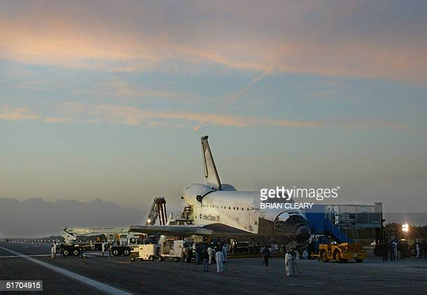 The Space orbiter Columbia sits on the tarmack as it is serviced by landing crew personnel after returning to earth at the Kennedy Space Center in...