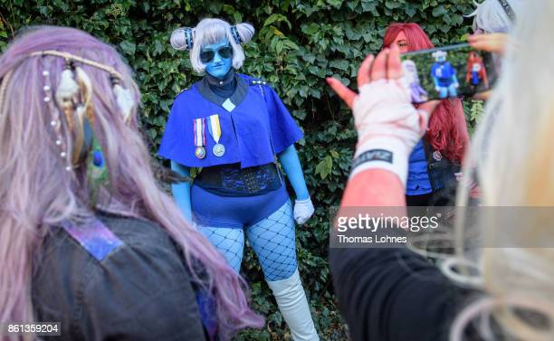 The 'Space Punk Rocks' cosplayer group pose at the 2017 Frankfurt Book Fair on October 14 2017 in Frankfurt am Main Germany The 11th German Cosplay...