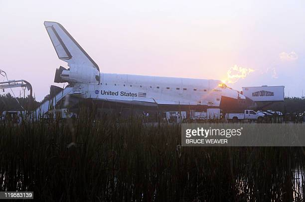 The space shuttle Atlantis is serviced on July 21 2011 after landing on runway 15 at Kennedy Space Center Florida completing the final shuttle...