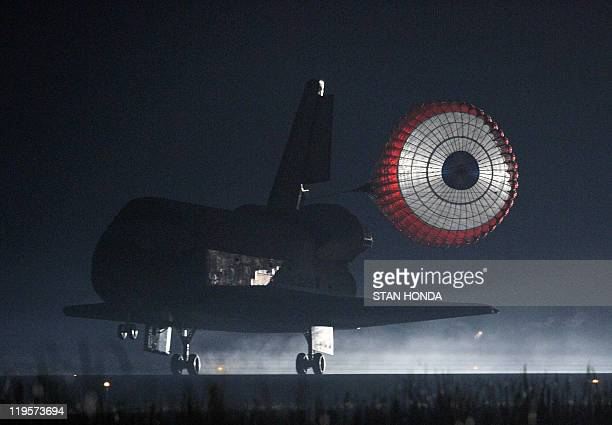 The space shuttle Atlantis lands in the predawn hours on July 21 2011 at Kennedy Space Center in Florida ending its 13day mission Atlantis touched...
