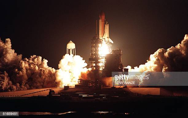 The Space Shuttle Atlantis leaves launch pad 39A early 15 May at the Kennedy Space Center to begin the sixth US docking mission to the Russian Space...