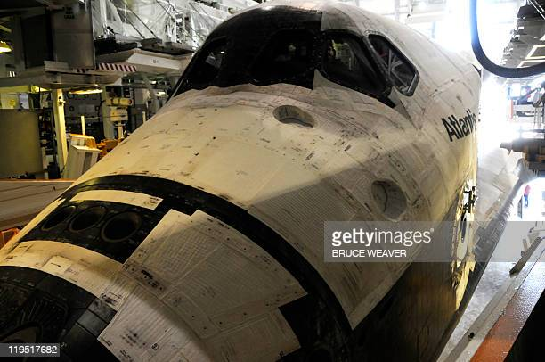 The space shuttle Atlantis sits in its hangar at the Orbiter Processing Facility July 21 2011 at Kennedy Space Center in Florida after it landed...