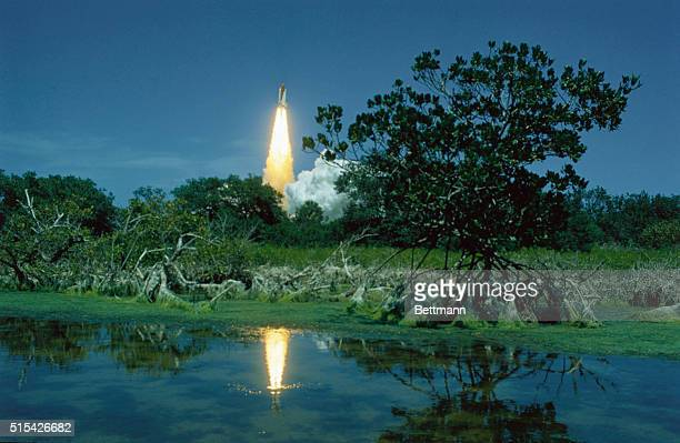 The Space Shuttle Challenger launching for the first time on its way to a fiveday STS6 Earthorbiting mission