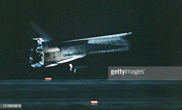 The space shuttle Columbia flares out for landing 27 July 1999 on runway 33 at Kennedy Space Center in Cape Canaveral, FL. The Columbia and her...