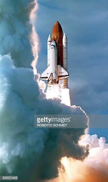 The Space Shuttle Columbia lifts off from launch pad 39B on its way to orbit at the Kennedy Space Center in Florida 19 November 1996 Columbia is on a...