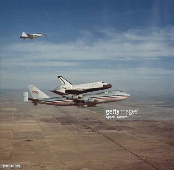 The Space Shuttle Columbia rides 'piggy-back' on NASA 905, a Boeing 747 Shuttle Carrier Aircraft , on its way back to the Kennedy Space Center in...