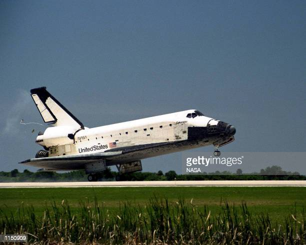 The Space Shuttle Columbia touches down on Runway 33 of Kennedy Space Center in Florida to complete the nearly 16day STS90 mission May 3 1998 Space...