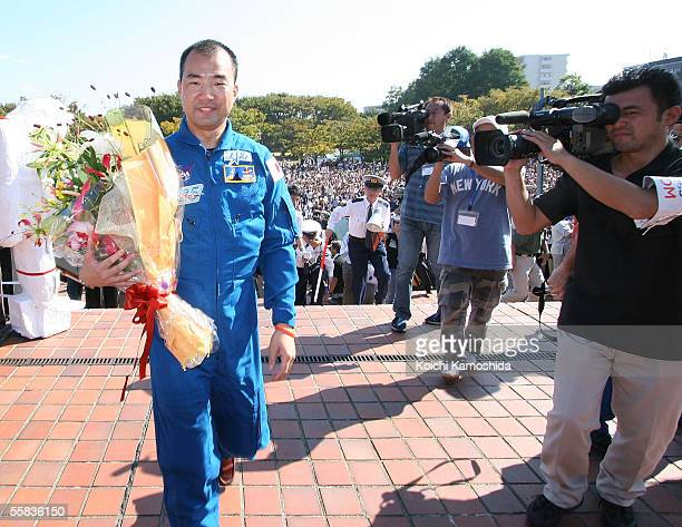 The Space Shuttle Discovery crew member Soichi Noguchi, of the Japan Aerospace Exploration Agency , waves to people as he parades in his home town of...