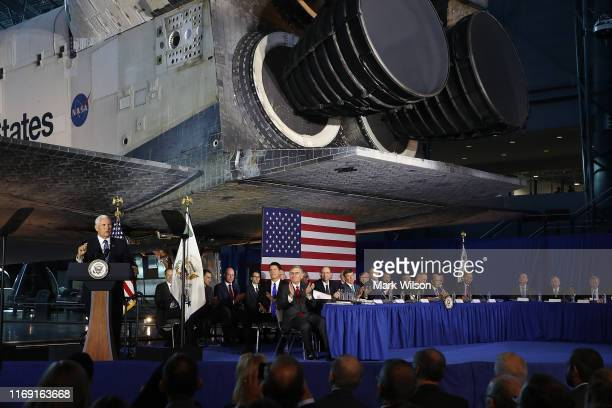 The Space Shuttle Discovery is the back drop as US Vice President Mike Pence speaks during the 6th meeting of the National Space Council on Leading...