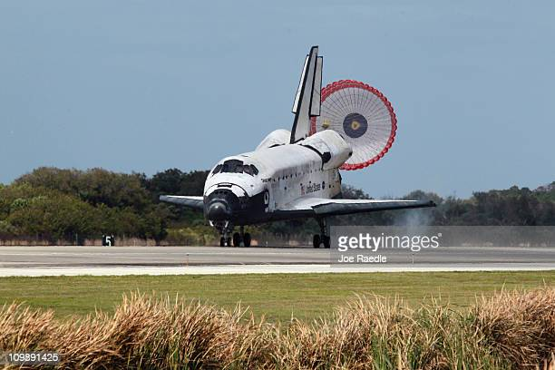 The space shuttle Discovery lands at Kennedy Space Center after returning for the last time from a space flight to the International Space Station on...