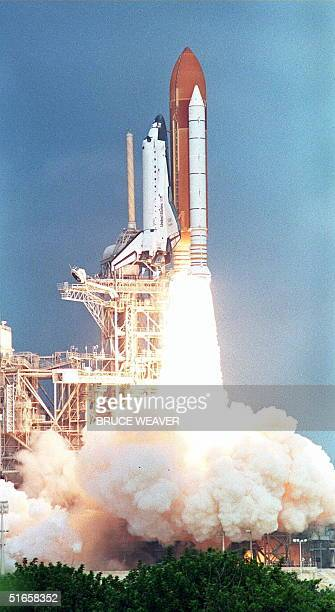 The space shuttle Discovery leaves the launch pad 07 August at Kennedy Space Center FL on its way to orbit The Discovery and her sixperson crew are...