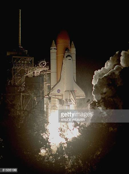 The Space Shuttle Discovery lifts off from the launch pad 19 December at Kennedy Space Center in Florida Discovery and her sevenman international...