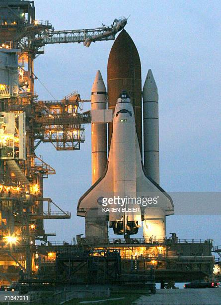 The space shuttle Discovery sits on launch pad 39B 30 June 2006 from the Kennedy Space Center in Florida The 115th shuttle flight will be headed by...