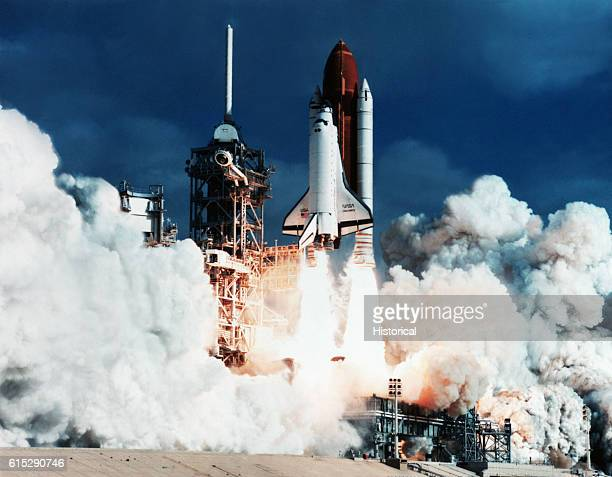 The Space Shuttle Discovery takes off from Pad 39B at the Kennedy Space Center Florida April 24 83351 am