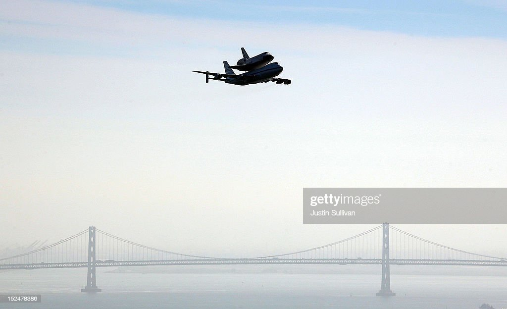The Space Shuttle Endavour flies on top of a modified 747 jumbo jet near the San Francisco Bay Bridge as it travels to Los Angeles on September 21, 2012 in Sausalito, California. The Space Shuttle Endeavour did a 4-1/2 hour tour over California landmarks before heading to Los Angeles International Airport where it will be prepared to be moved to its new permanent home at the California Science Center in downtown Los Angeles. The shuttle will be on public display starting October 30.