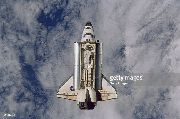 The Space Shuttle Endeavour approaches the International Space Station December 2 2000 in this photo taken aboard the space station by one of the...