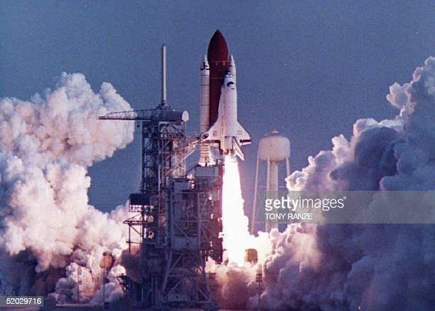The Space Shuttle Endeavour blasts off 13 January 1993 from Kennedy Space Center FL Endeavour is carrying a fiveperson crew on a sixday mission to...