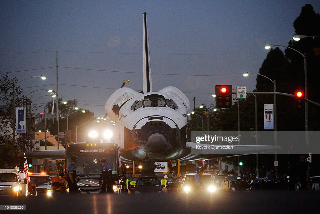 The space shuttle Endeavour is transported pre-dawn to The Forum arena for a stopover and celebration on its way to the California Science Center from Los Angeles International Airport (LAX) on day two on October 12, 2012 in Inglewood, California. The space shuttle Endeavour is on 12-mile journey from Los Angeles International Airport to the California Science Center to go on permanent public display.