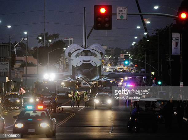 The space shuttle Endeavour is transported predawn to The Forum arena for a stopover and celebration on its way to the California Science Center from...