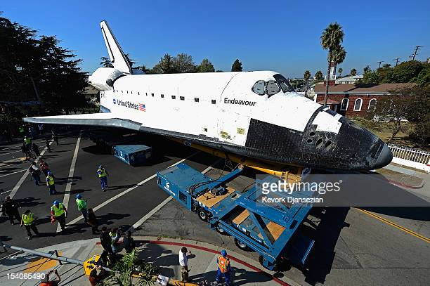 The space shuttle Endeavour makes a turn at an intersection as it is transported to the California Science Center from Los Angeles International...