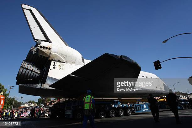 The space shuttle Endeavour moves along Manchester Avenue as it is transported from Los Angeles International Airport to the California Science...