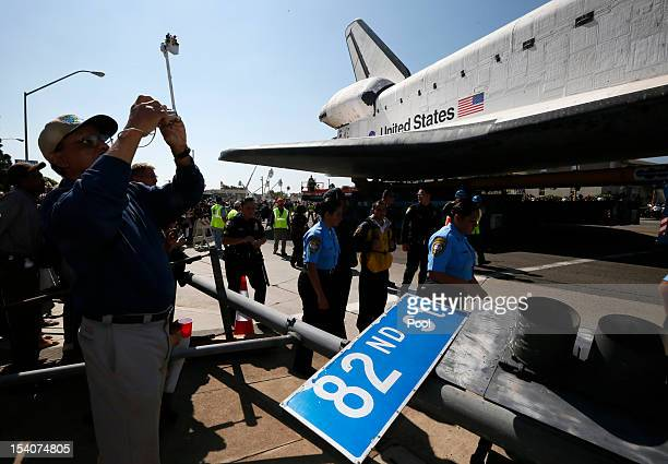 The Space Shuttle Endeavour passes a downed road sign as it is moved to the California Science Center on October 13 2012 in Inglewood California The...
