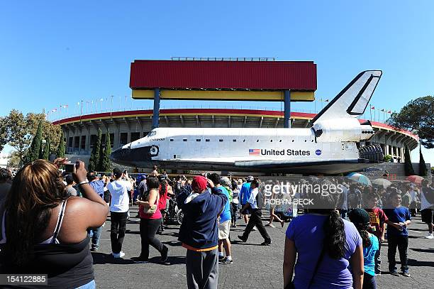 The Space Shuttle Endeavour passes the Los Angeles Memorial Coliseum as it arrives at the end of its journey to the California Science Center in...