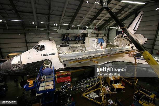 The space shuttle Endeavour's payload bay doors are wide open as the California Science Center installs Endeavour's final payload a configuration...