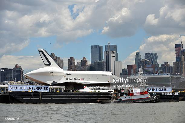 The space shuttle Enterprise arrives by barge at the Intrepid Sea Air and Space Museum in New York June 6 2012 where it will be permanently displayed...
