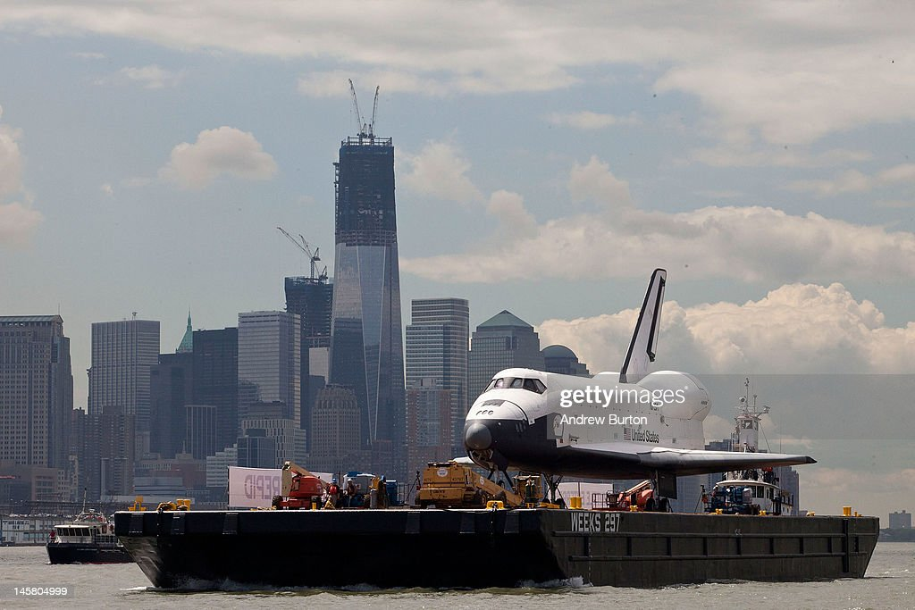 The space shuttle Enterprise is brought past the the Financial District on a barge on June 6, 2012 in New York City. The shuttle is on it's way to the USS Intrepid, where it be on display for viewing by the general public. NASA's space shuttle program came to an end in August, 2011, after 30 years of service.