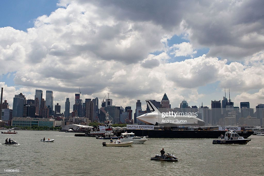 The space shuttle Enterprise is pulled past the New York skyline on a barge on June 6, 2012 in New York City. The shuttle is on it's way to the USS Intrepid, where it be on display for viewing by the general public. NASA's space shuttle program came to an end in August, 2011, after 30 years of service.