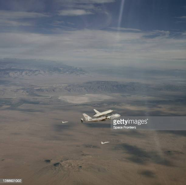 The Space Shuttle Enterprise rides 'piggy-back' on a Boeing 747 Shuttle Carrier Aircraft during the second free flight of the Shuttle Approach and...