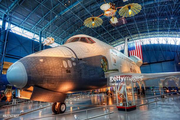 CONTENT] The Space Shuttle Enterprise within a hangar in the National Air and Space Museum's Steven F UdvarHazy Center at Dulles International...