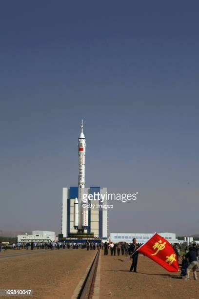 The spacecraft of Shenzhou X is seen on top of the Long March 2F launch vehicle at the launch pad at the Jiuquan Satellite Launch Center on June 3...