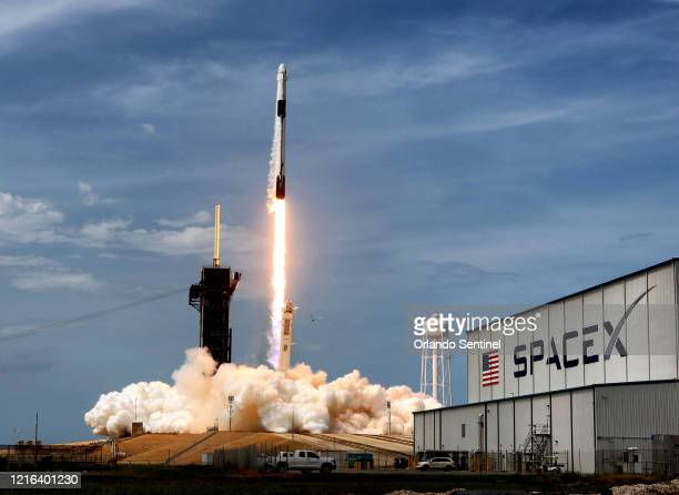The SpaceX Falcon 9 rocket, carrying astronauts Doug Hurley and Bob Behnken in the Crew Dragon capsule, lifts off from Kennedy Space Center, Fla., on...