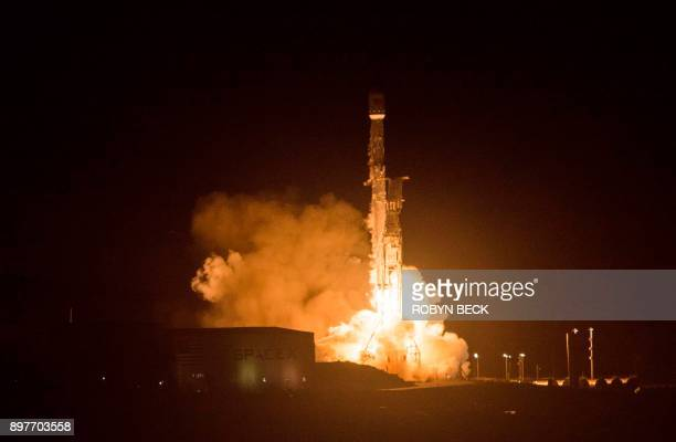 The SpaceX Falcon 9 rocket launches from the Space Launch Complex 4 at Vandenberg Air Force Base in Lompoc California on December 22 2017 SpaceX...