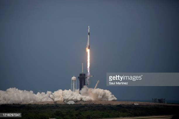 The SpaceX Falcon 9 rocket launches into space with NASA astronauts Bob Behnken and Doug Hurley aboard the rocket from the Kennedy Space Center on...