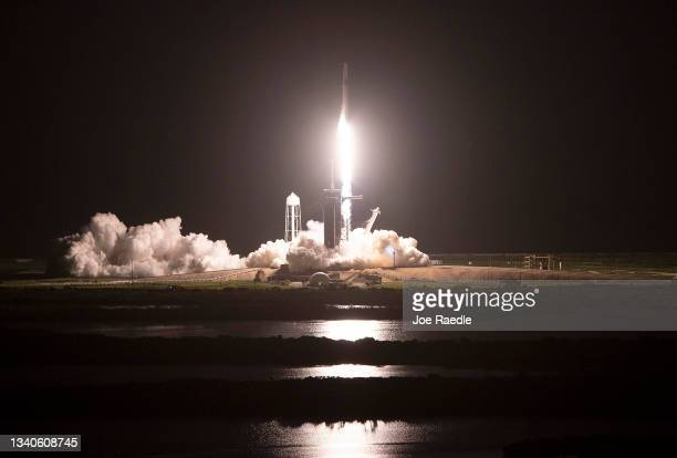 The SpaceX Falcon 9 rocket with Crew Dragon capsule lifts off from launch Pad 39A at NASA's Kennedy Space Center for the first completely private...