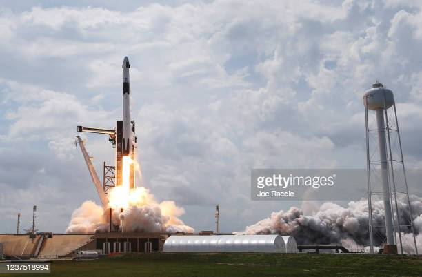 The SpaceX Falcon 9 rocket with the manned Crew Dragon spacecraft attached takes off from launch pad 39A at the Kennedy Space Center on May 30, 2020...