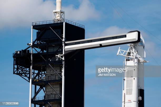 The SpaceX Falcon 9 rocket with the unmanned Crew Dragon capsule on its nose sits at Kennedy Space Center in Florida on March 1 2019 Liftoff of the...