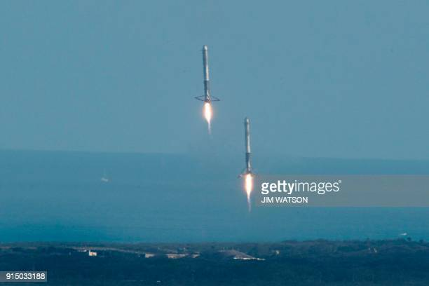 The SpaceX Falcon Heavy booster rockets land at Kennedy Space Center, Florida, on February 6, 2018. - The world's most powerful rocket, SpaceX's...