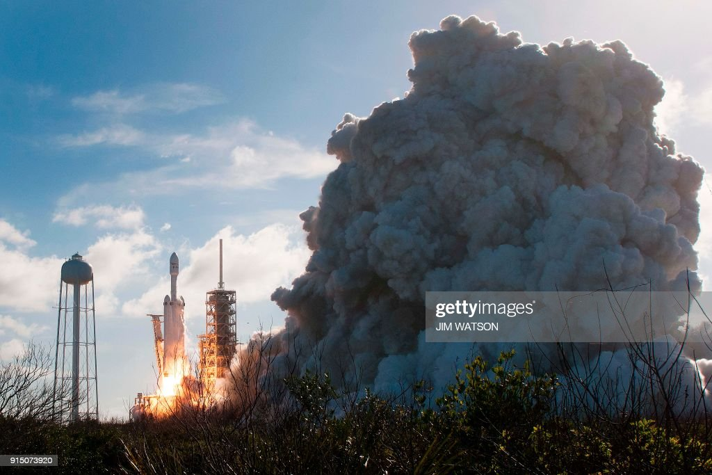 The SpaceX Falcon Heavy launches from Pad 39A at the Kennedy Space Center in Florida, on February 6, 2018, on its demonstration mission. The world's most powerful rocket, SpaceX's Falcon Heavy, blasted off Tuesday on its highly anticipated maiden test flight, carrying CEO Elon Musk's cherry red Tesla roadster to an orbit near Mars. Screams and cheers erupted at Cape Canaveral, Florida as the massive rocket fired its 27 engines and rumbled into the blue sky over the same NASA launchpad that served as a base for the US missions to Moon four decades ago. WATSON