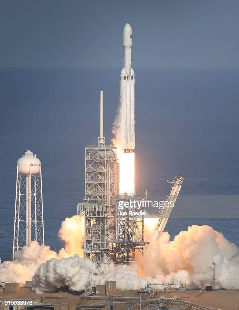The SpaceX Falcon Heavy rocket lifts off from launch pad 39A at Kennedy Space Center on February 6, 2018 in Cape Canaveral, Florida. The rocket is...